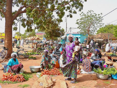 The ordinary people of Burkina Faso have seen little or no benefit from the neo-colonial model of development imposed by outside powers. Photo: market in Ouagadougou by Rita Willaert via Flickr.