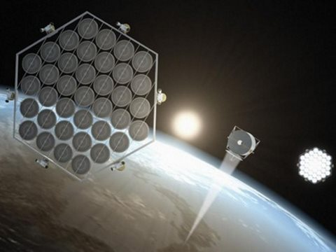 Solar panels in space work very efficiently. But how to get them there? And how to get the power down to Earth? Image: John MacNeil via Greenpeace.