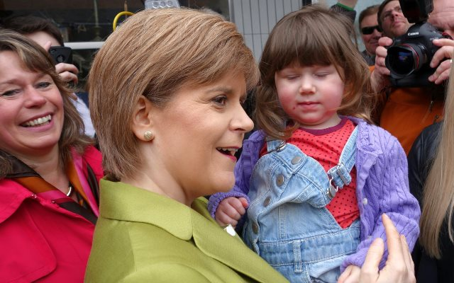 When Scotland's First Minister Nicola Sturgeon isn't kissing babies, she manages to find time to reach a friendly understanding with fracking bosses. Photo: Barbara Agnew via Flickr (CC BY-NC).