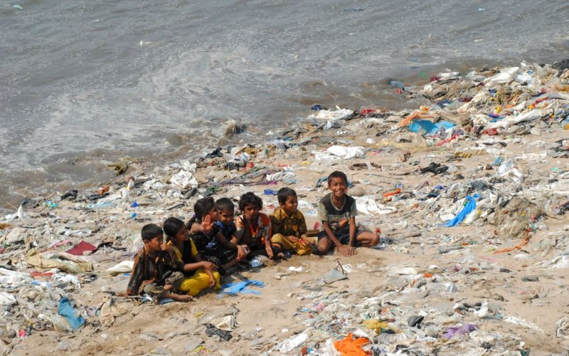 Children playing on a 'plastic beach' at the mouth of Versova Creek near Mumbai - an area formerly home to large tracts of mangroves and Great Egrets. Photo: Ravi Khemka via Flickr (CC BY).