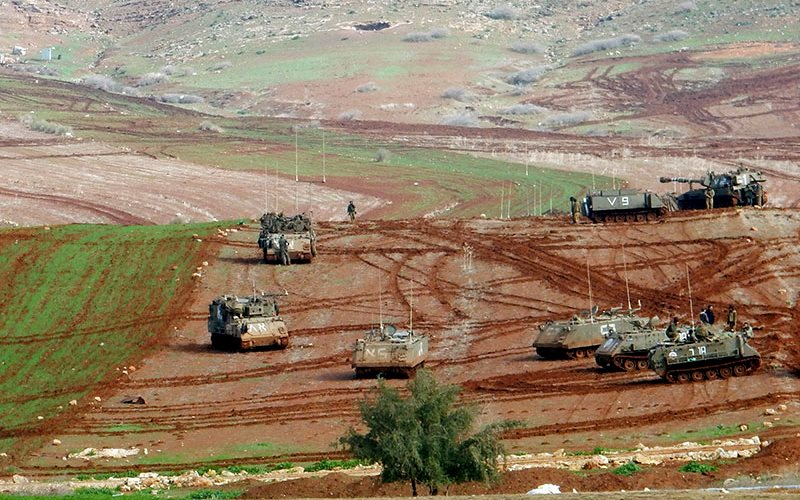 Military tanks in fields cultivated by a-Ras al-Ahmar community, partially seen in the top-left corner. Photo: 'Aref Daraghmeh, B'Tselem, 27 Jan. 2016.