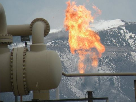 Flaring of unwanted hydrocarbons at a natural gas refinery in the Piceance Basin of Colorado. Photo: Tim Hurst  via Flickr.