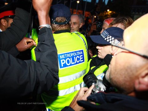 Donnachadh McCarthy stands his ground against a repressive police presence at OccupyDemocracy. Photo: Fields of light photography.