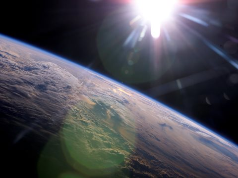 The answer to Earth's energy needs is floating in the skies above. Photo: Conceptual Image Lab, NASA's Goddard Space Flight Center. Earth photo courtesy of NASA/ISS Expedition 13 crew.