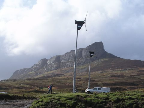 Democratic energy: wind turbines under An Sgurr, Eigg, Scotland. Photo: W. L. Tarbert / Wikimedia Commons.