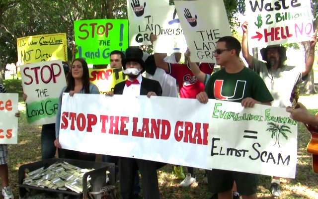 A 'money-burning' event organised by the Miami Tea Party to oppose a 46,000 acre conservation land purchase - but were the 'protestors' all actors? So it would seem. Photo: from Youtube video by Miami Tea Party.