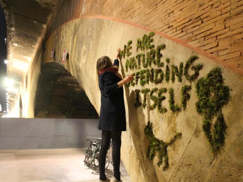 'We are Nature defending itself': an activist makes moss graffiti in Paris with the slogan of the Climate Games. Photo: @JEBA_JE via Twitter.