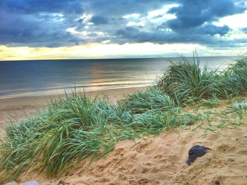 Behind the beach and dunes of Druridge Bay, planning permission for a 350 hectare opencast coal mine has been granted. But if turned into a solar power farm, the same land would produce as much electricity as the coal after 70 years. Photo: Doug Belshaw v