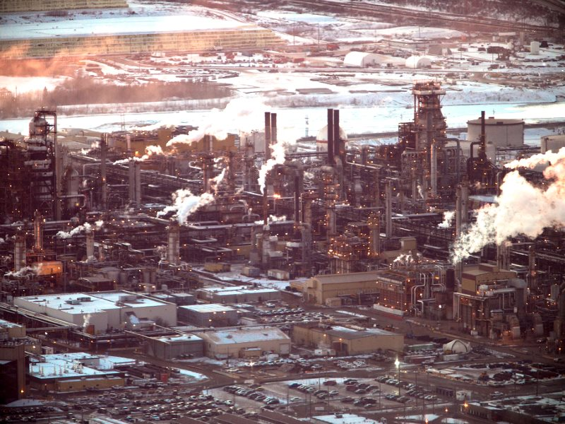 It may be possible to transform this landscape into a green energy park, or back to wilderness - but it's not going to happen soon enough without a corresponding political transformation! Tar sands refinery at Fort McMurray, Alberta, Canada. Photo: kris k