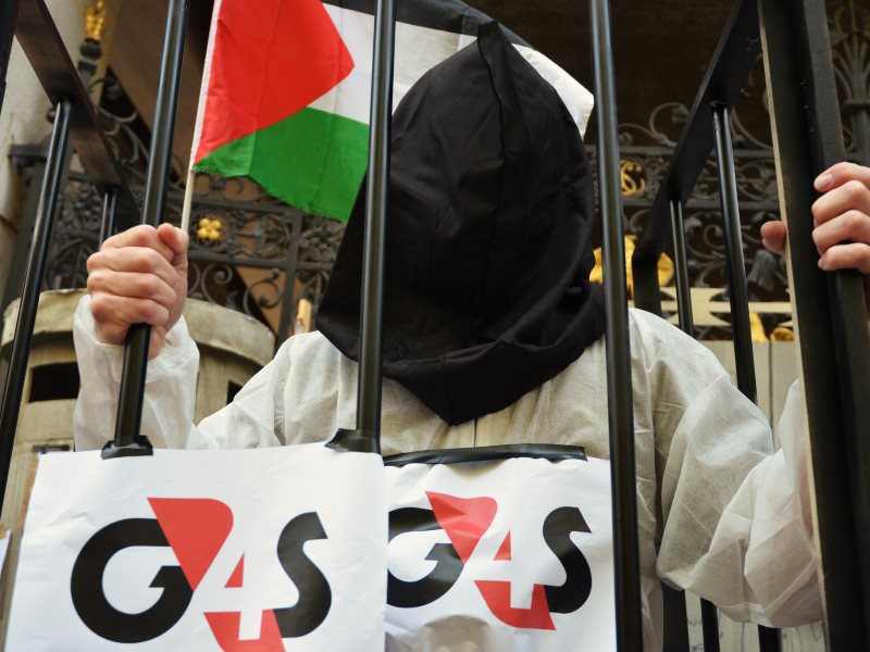 G4S provides security systems for prisons which hold Palestinian political prisoners from occupied Palestinian territory inside Israel, in contravention of Article 76 of the Fourth Geneva Convention. Photo: Anti-G4S demo in London, June 2016 by Darren Joh