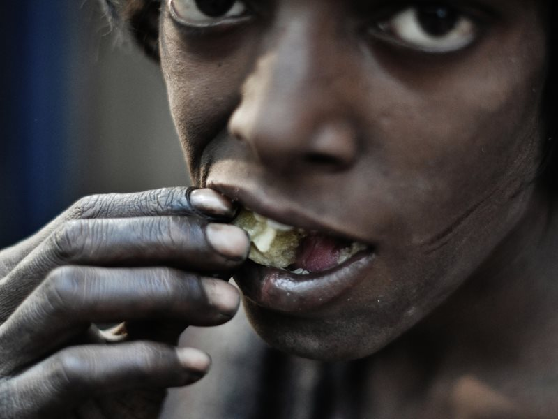 Hunger: a street-dweller in New Delhi, India. Photo: johnjodeery via Flickr (CC BY).