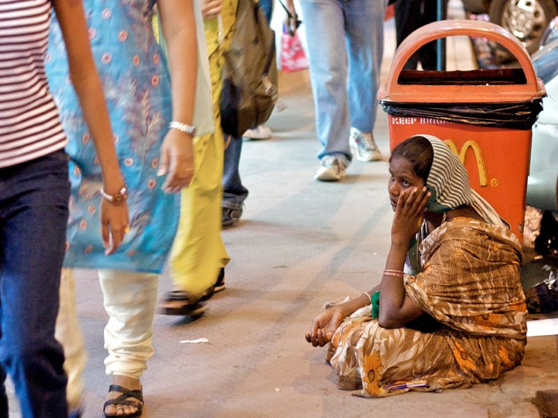 CDC's development model in microcosm? Girl begging outside McDonalds outlet, India. Photo: Jon Ardern via Flickr (CC BY-NC-SA).