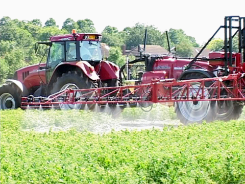 A regular sight in rural areas - pesticides being applied to crops. Photo: Billy Ridgers.