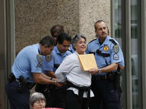 A #NoKXL activist is arrested during a sit-in outside TransCanada's Houston offices in 2013. Photo: Aaron M. Sprecher via Flickr.
