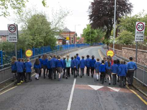 A class of 33 school children reclaiming a street near their school. The same number of child cyclists and pedestrians were killed on the roads in 2012. Photo: Bob Collier/PA Wire.