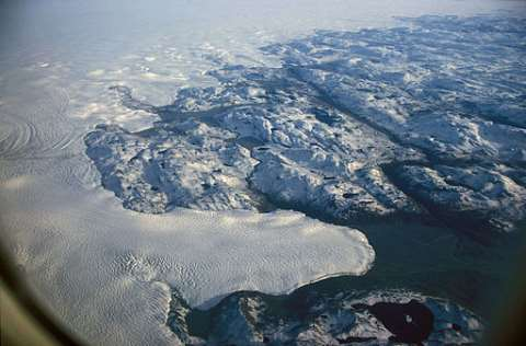 Melting away: an aerial view of the margin of Greenland's threatened ice sheet. Photo: Hannes Grobe / Alfred Wegener Institute via Wikimedia Commons.