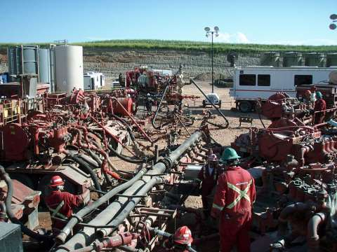 Thanks to higher methane emissions and lower production than declared, gas from fracking is as bad for climate as coal. Photo: Fracking the Bakken Formation in North Dakota. Credit: Joshua Doubek / Wikimedia Commons.