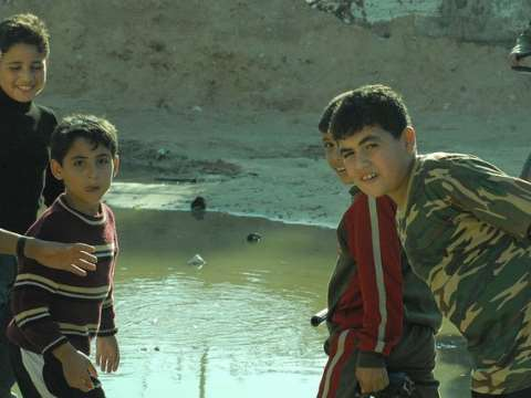 Palestinian boys showing the Free Gaza passengers the lakes of untreated sewerage inside Gaza. Photo: Free Gaza movement via Flickr.