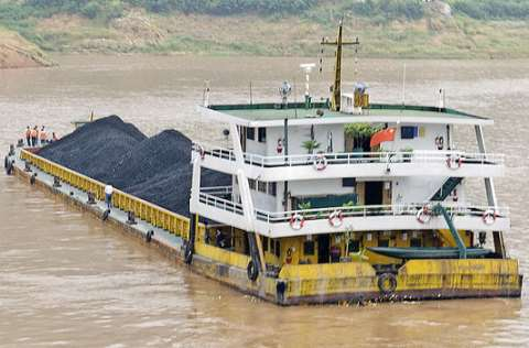Will this coal on a Chinese barge on the Yangtze River end up being 'consumed' in the US and Europe? Photo: Marshall Segal via Flickr.
