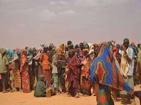 Somalis displaced by drought in 2011 queue at a refugee camp in Ethiopia. Image: Cate Turton/DFID via Wikimedia Commons.