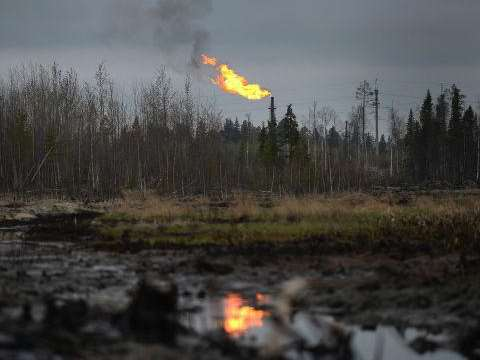 Crude oil seeps through the ground, poisoning the land the Khanty live off. Photo: © RIA Novosti / Ramil Sitdikov.