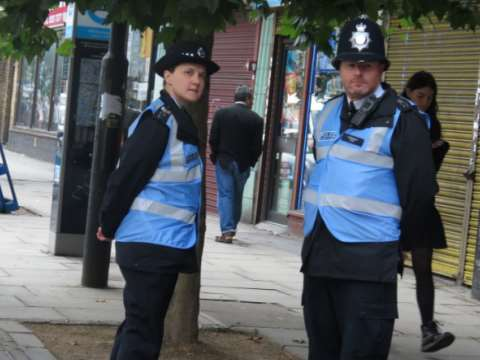 Police Liaison Officers at work - easily recognised by their 'blue bibs'. Just remember what they are there for. Photo: Netpol.