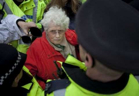 Anne Power surrounded by police at an anti-fracking protest at Barton Moss, December 2013. Photo: Steven Speed / SalfordStar.com.