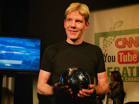 With all that money, he's got plenty to smile about. Bjorn Lomborg at the CNN / You Tube Debate on Climate Change. Photo: Mat McDermott via Flickr.