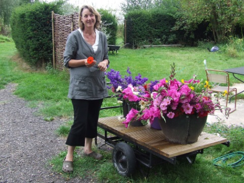 Marina with cut flowers from the garden. Photo: Martin Large / Biodynamic Land Trust.