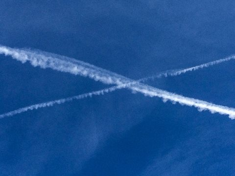 Blue skies beckon for British democracy, and not only in Scotland. Saltire drawn by vapour trails over the Falls of Foyers, Scotland. Photo: David Sim via Flickr.