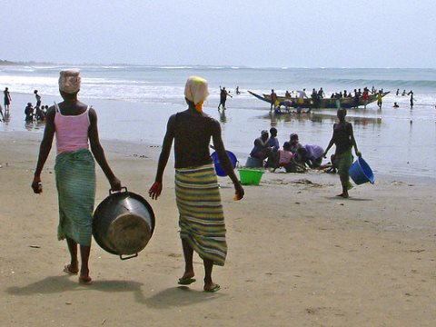 Fisherfolk on the beach, The Gambia. Photo: Angus Kirk via Flickr.