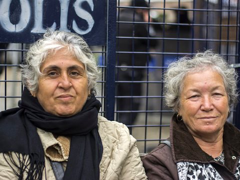 Zekiye Ozdemir and Gulseren Caliskan, both 70, maintain their daily vigil directly in front of a large iron police barrier  at the construction site on the edge of Validebag Grove, Istanbul. Photo: Nick Ashdown.