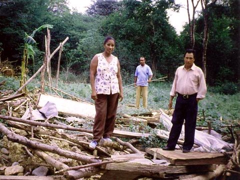 Villagers stand in the ruins of their house after the 2001 eviction of Tabaco. Photo: London Mining Network.