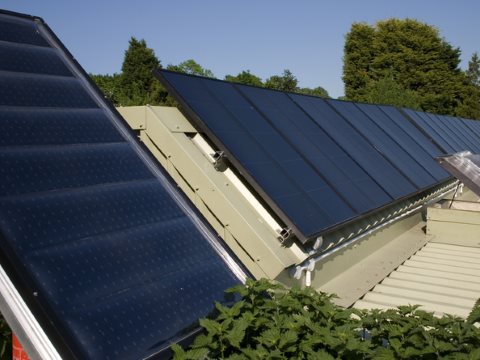 Regular PV solar cells on the Brighton Earthship in the south of England  Dominic Alves, CC BY-SA.