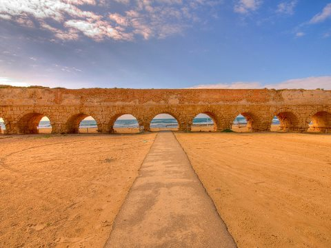 This roman aqueduct near Haifa in modern-day Israel took water to Caesaria, the civilian and military capital of Judaea. But ultimately, most of the water flowed to Rome itself - if in virtual form. Photo: C. J.™ via Flickr.