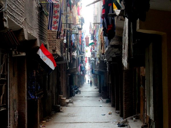 A typically dark, narrow Cairo street in the Boulaq El Dakrour district. Photo: Patrick Keddie.