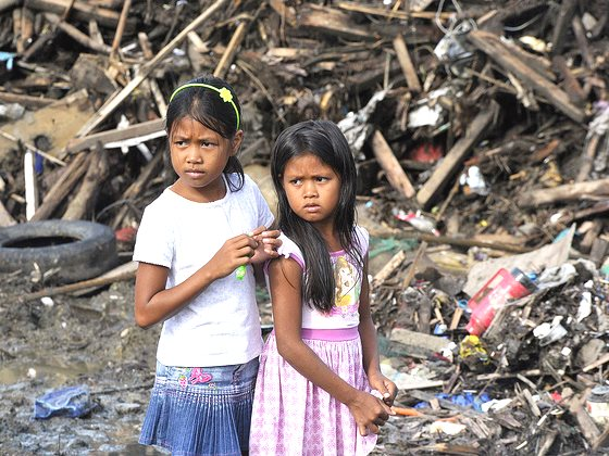 'The kingdom of God belongs to such as these'. Children in Tacloban City, Leyte Province, Philippines, amid the wreckage of Super Typhoon Yolanda / Hiyan, 21st December 2013. Photo: United Nations Photo via Flickr (CC BY-NC-ND).