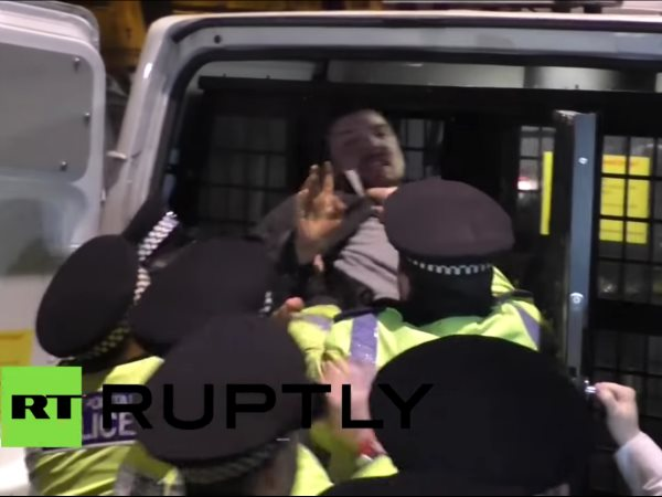 An Occupy Democracy protester is arrested by police in Parliament Square on 14th February 2015. Photo: still from RT report.