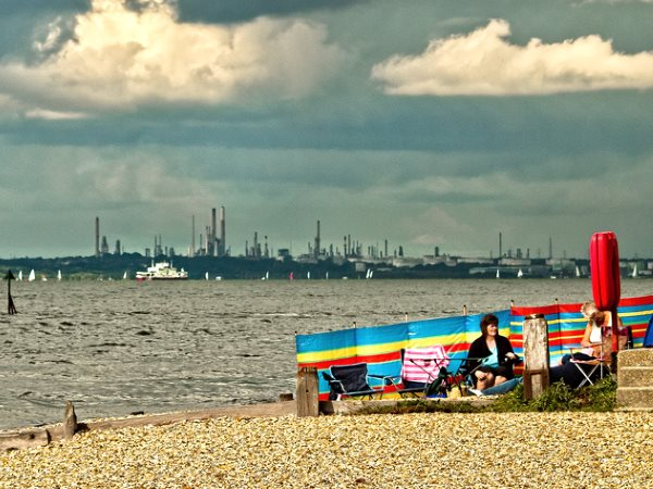 Fawley power station and oil refinery in Hampshire, England, from the beach at Hillhead. Photo: Anguskirk via Flickr (CC BY-NC-ND 2.0).