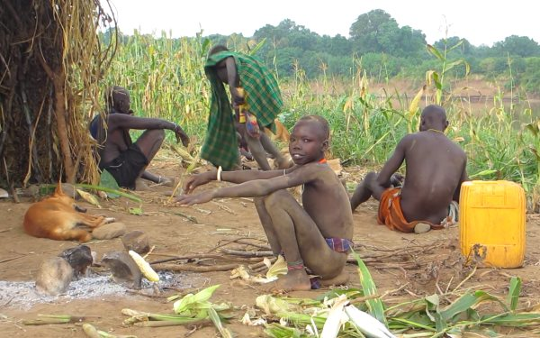 In happier times, a Kwegu family on a maize field next to the Omo river. Photo: via Survival International.