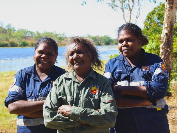Indigenous rangers like Yugul Mangi senior women (from left to right) Edna Nelson, Cherry Daniels and Julie Roy, are crucial guardians of the outback environment. Photo: Emilie Ens, Author provided.