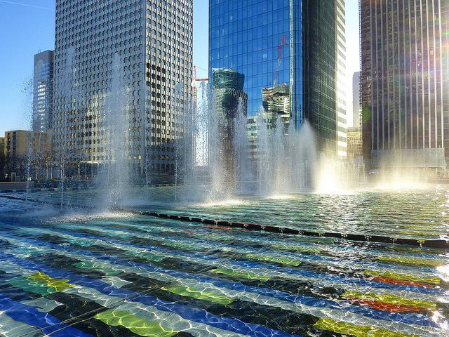 Paris-based Veolia and Suez are aggressive global companies running public water supply in cities around the world. But water in Paris itself (see here at La Defense) has been taken back under municipal control and ownership. Photo:  jean-marc via Flickr