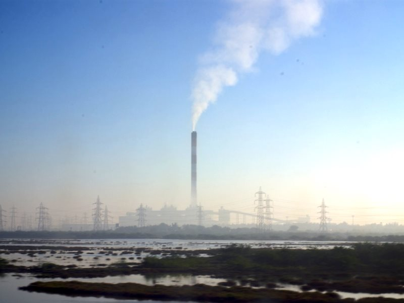 India's human rights and environment are going up in smoke - sacrificed to an aggressive coal-fired development path. Photo: coal power plant outside Hyderabad, Andhra Pradesh, India, by Reuben Stanton via Flickr (CC BY-NC).