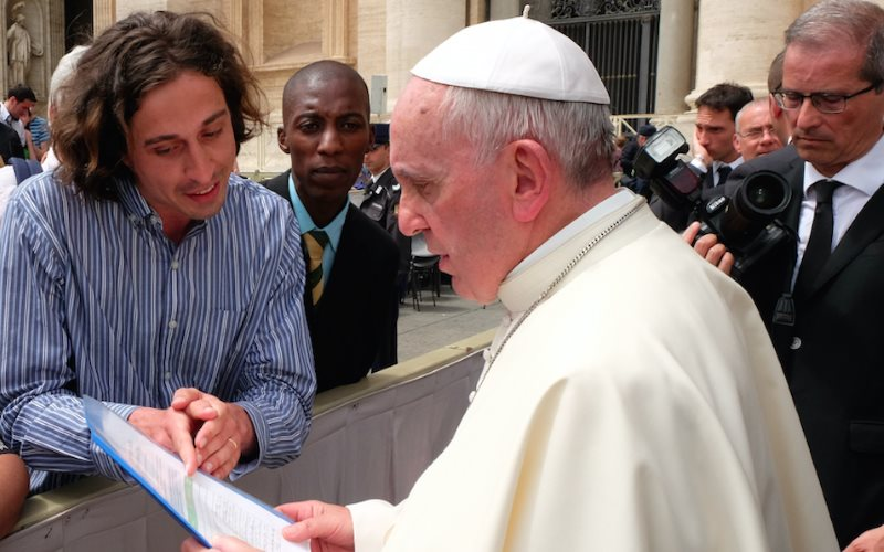 Pope Francis reads the Catholic Climate Petition with GCCM representatives Tomás Insua from Argentina and Allen Ottaro from Kenya. Photo: Fotografia Felici.