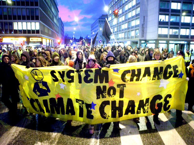 'System change not climate change' banner at the 2009 COP15 UN climate talks in Copenhagen, Denmark. Will Paris be any more successful? Photo: kris krüg via Flickr (CC BY-NC-ND).