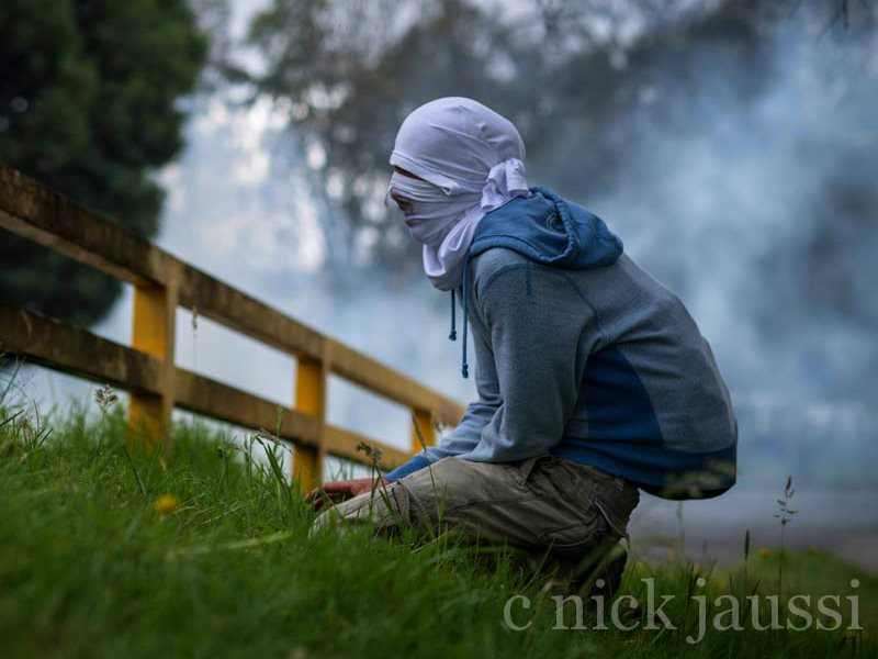 This time, it's tear gas: masked man at a farmers and student protest in Colombia, August 2013. Photo: Nick Jaussi via Flickr (CC BY-NC-SA).