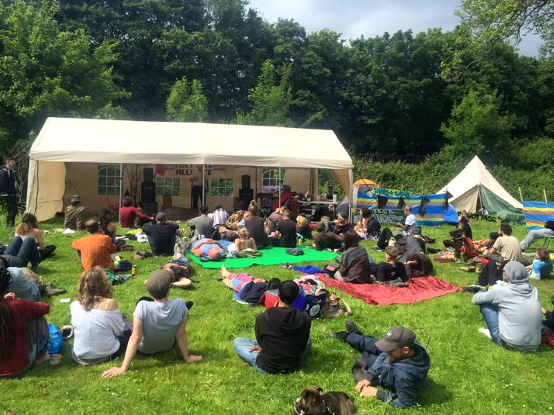 A rave? People gather to hear a lecture at the Democracy Festival near Runnymede yesterday. Photo: John Phoenix via Facebook.