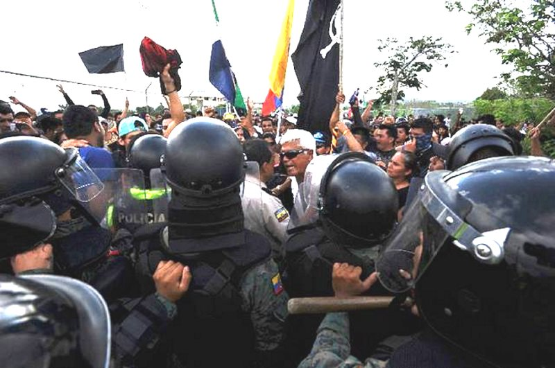 Ex-congressman Eduardo Veliz (white hair) leads a protest at San Cristobál airport, Galapagos, against excessive development, prior to his arrest. Photo: El Colono (Galapagos newspaper).