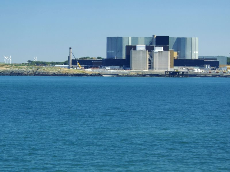 Wylfa or windmills? Wylfa nuclear power station on Anglesey, along with some greener alternatives. Photo:  Eifion via Flickr (CC BY-NC-SA).