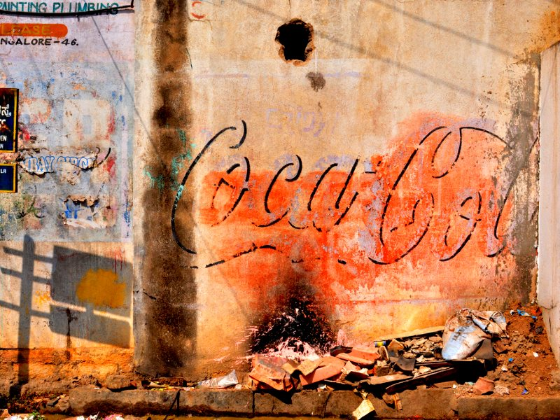 It will take more than PR puff to restore Coca-Cola's reputation in India. Wall-painted sign in Bangalore, India. Photo: Syed Nabil Aljunid via Flickr (CC BY-NC).